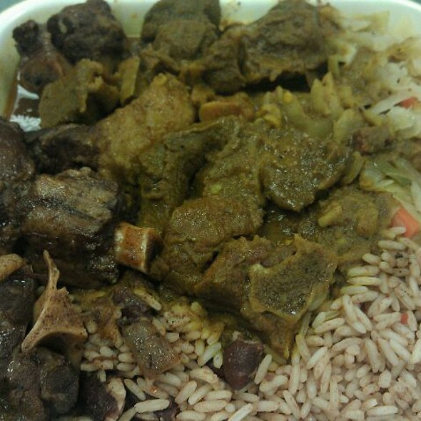 Curry Goat, Oxtails, Rice And Beans, And Cabbage