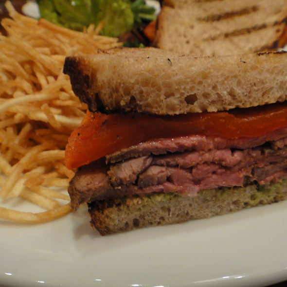 Oven Roasted Lamb Sandwich - w/grilled eggplant spread, sun dried tomatoes, pesto aioli, marinated olives on toasted New York rye, w/salad & fries @ Olympic Club