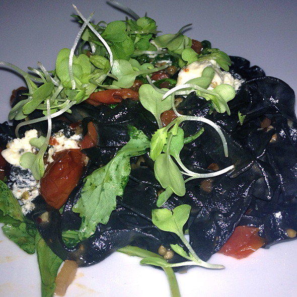 Squid Ink fettuccine with feta, tomatoes and arugula