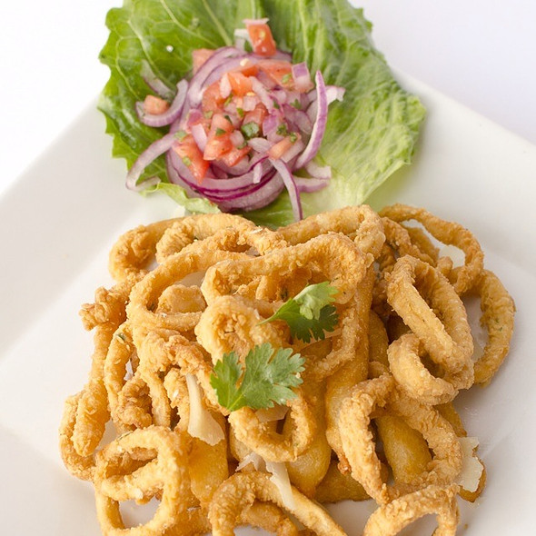 Fried Calamari Served With Fried Yuca @ Fusion And Flavors Peruvian Restaurant