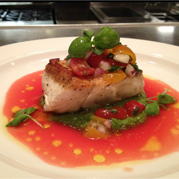 Halibut with local tomato vinaigrette @ Wolfgang Puck American Grille