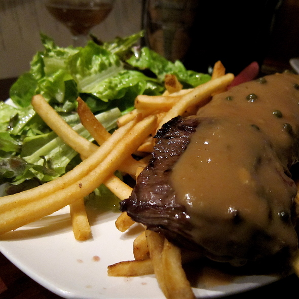 Estancia Beef Flat Iron Steak marinated in pale ale & grilled to order, served w/brandy & green peppercorn sauce, organic mixed greens salad & fries