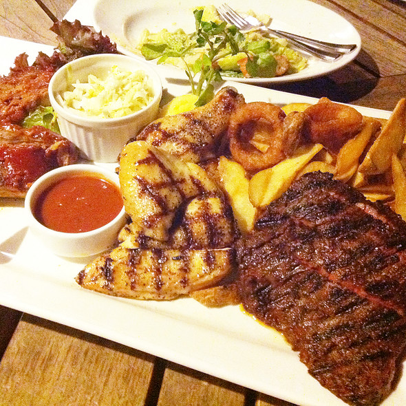 Jumbo grilled meat combo plate with beer Chicken, BBQ ribs and skirt steak