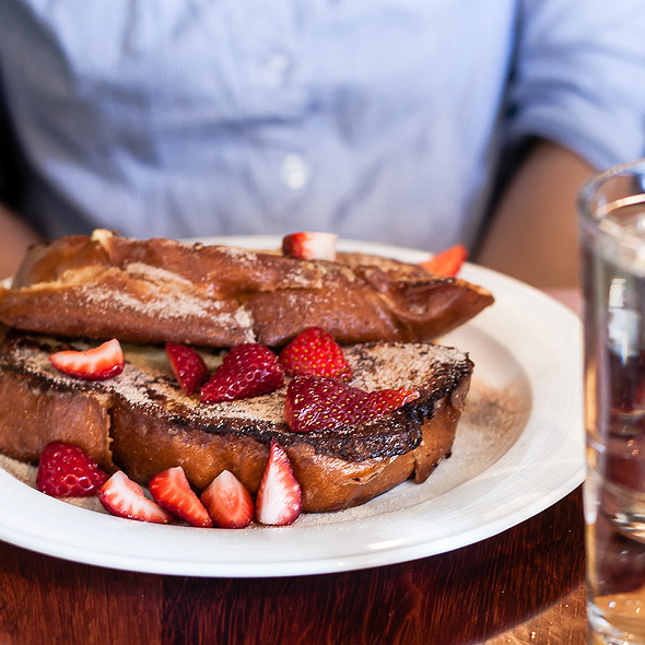 Challah Custard Toast with Korintji Cinnamon Sugar topped with Fresh Strawberries @ Olea
