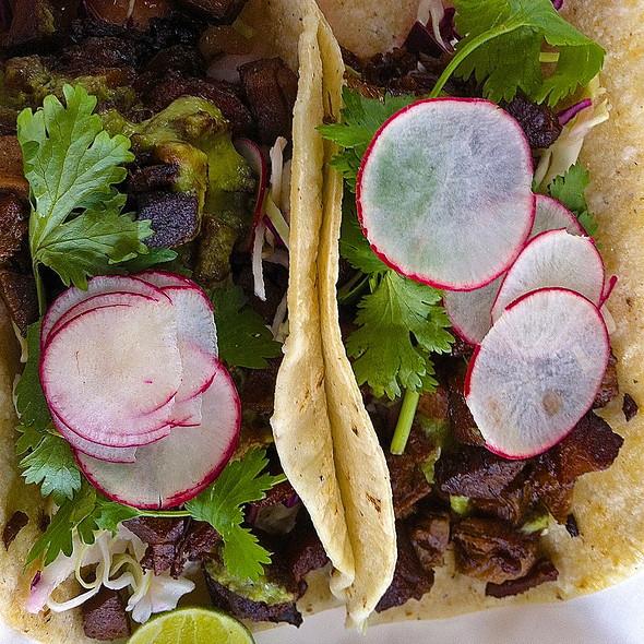 Sigig Tacos/ Lime & Soy Sauce Braised Pork/ Avocado Salsa Verde/ Cilantro/ Radishes/ Cabbage Salad/ Corn Tortillas