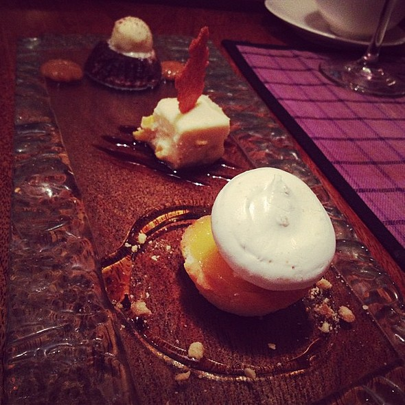 Trio dessert sampler, from top, decadent molten chocolate cake, maja Blanca cheesecake and my favorite kalamansi tart topped with meringue. Perfect cap to a perfect meal. At Chef Laudico Bistro Filipino The Fort. @ Chef Laudico Bistro Filipino
