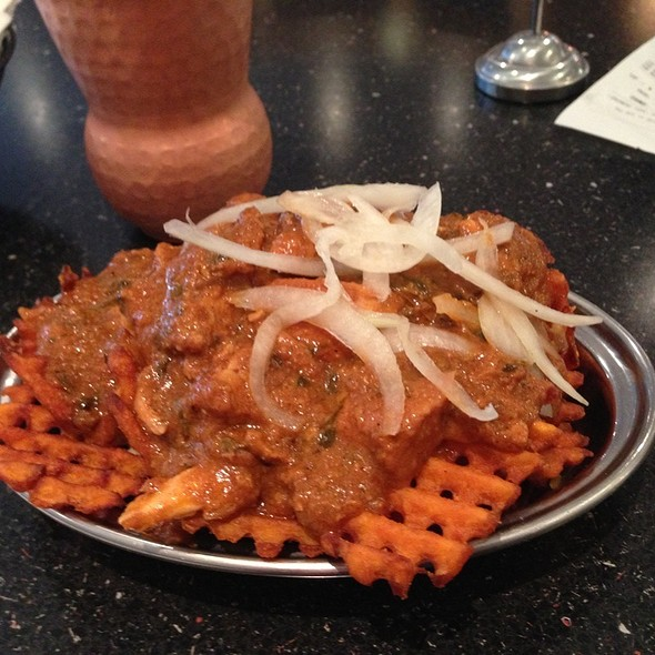 chicken tikka masala sexy fries @ Curry Up Now Restaurant & Truck