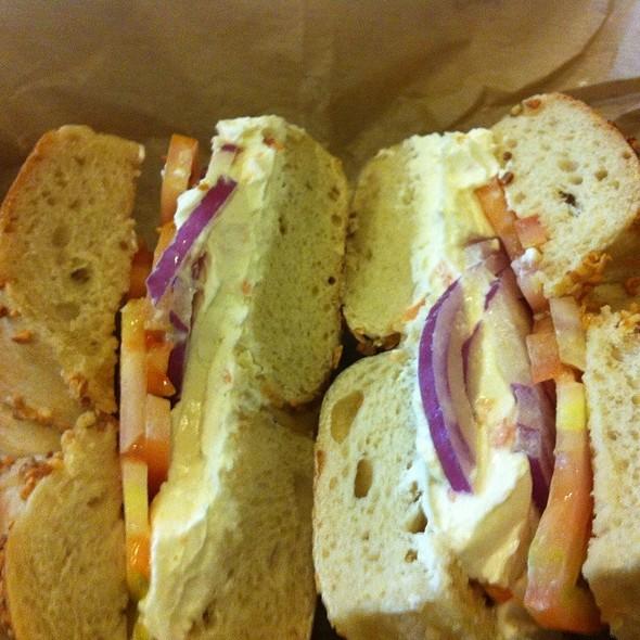 Garlic Bagel With Lox Spread, Tomato And Onion @ Brooklyn Bagel & Coffee Co