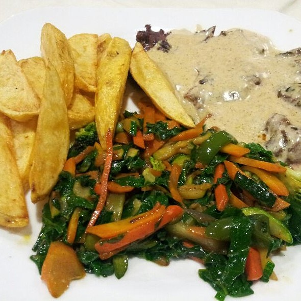Fillet Steak With Wedged Potatoes, Greens And Sauce @ Hidden Agenda Bar And Restaurant