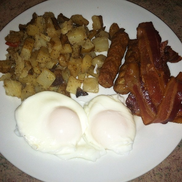 Poached Eggs, Bacon, Sausage, And Potatoes