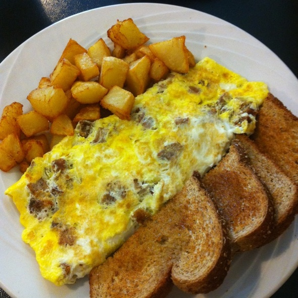 Three Cheese Almost Rolled Omelet With Tomatoes Recipe — Dishmaps