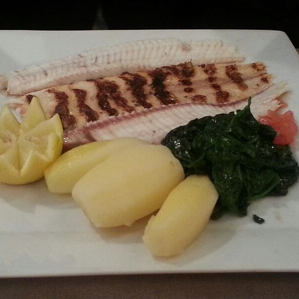 Grilled Sole, Boiled Potatoes And Fresh Spinach.