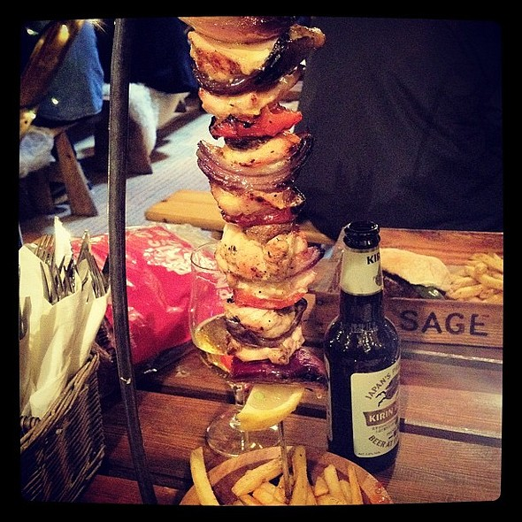 Hanging kebab (chicken). From The Oast House in Spinningfields. Tasted great. Garlic sauce poured from top and drips down on to kebab and chips. Mmmmmm. @ The Oast House