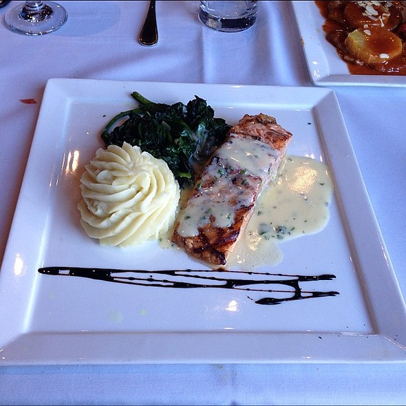Grilled Salmon over sautéed spinach w/ champagne cream sauce. @ Prespa