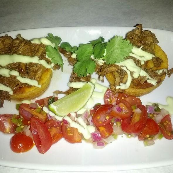 Adobo Pork Tamals with Avocado Crema @ Tastebuds American Bistro
