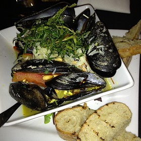 Steamed Prince Edward Island Mussels White Wine in Saffron Broth, Roma Tomatoes, Toasted Pine Nuts & Grilled Bread