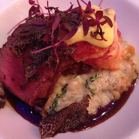 Sliced Filet Mignon Over Truffle Risotto With Applewood Curred Lobster And Bernaise Sauce Over Red Wine Reduction - Iridescence, Detroit, MI