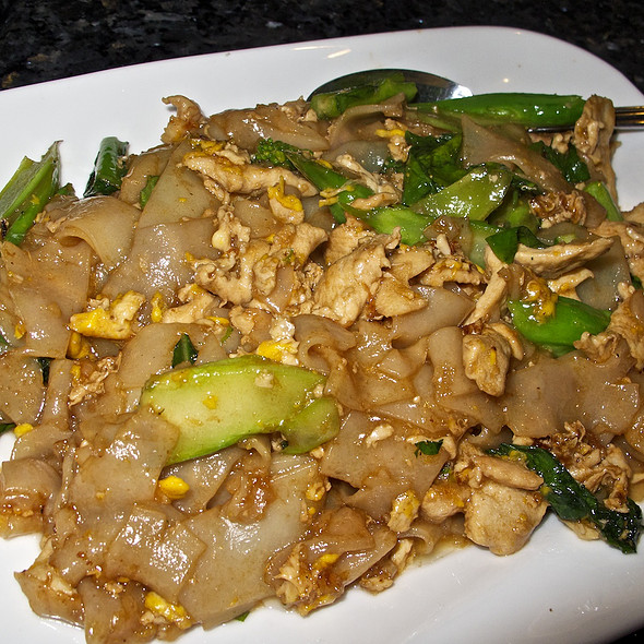 Pad See Ewe with chicken - stir fried rice noodles with egg and broccoli