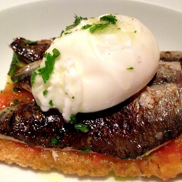 Poached Egg On A Toast With Sardines