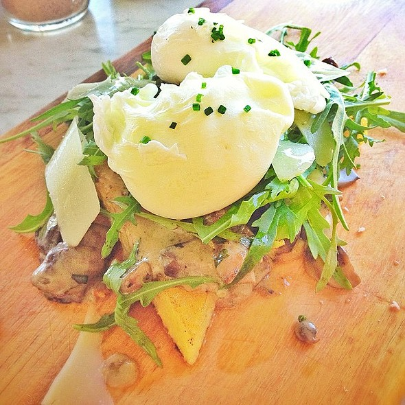 Poached eggs, mushrooms, truffle oil, pecorino, rocket, on lemon & thyme polenta. @ Is It Cafe