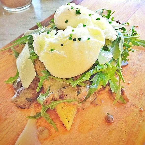 Poached eggs, mushrooms, truffle oil, pecorino, rocket, on lemon & thyme polenta. @ Is It Cafe