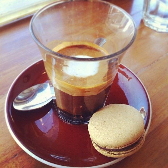 Long Machiatto With A Coffee Macaron