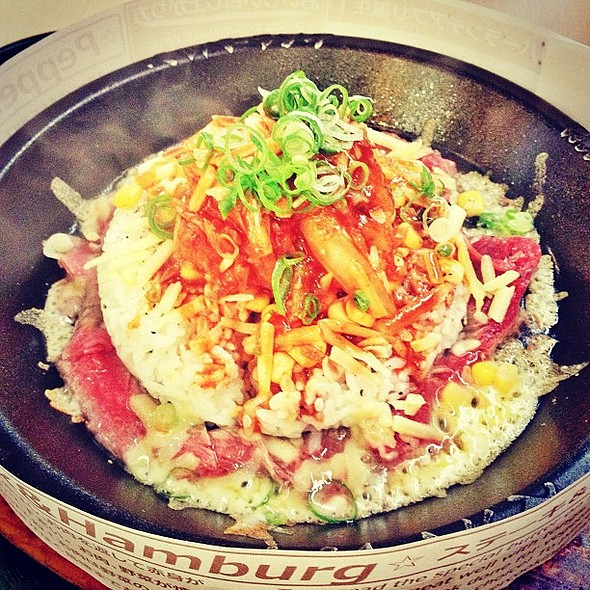 I am the babe Bourdain. Peppercorn marinated raw beef, melted cheese, kimchi, corn, and rice on a steaming, sizzling hot plate. @ Pepper Lunch
