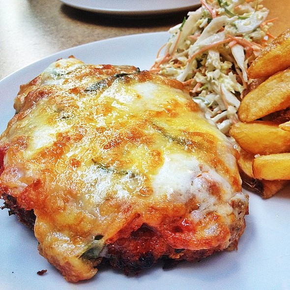The @captainmelville parma with Napoli, basil, 3 cheeses with hand cut chips and coleslaw. @captain_melville one of the best chicky parmas I've had in awhile and thank you for not putting the Parma on the chips. No one likes soggy chips. When will everyon @ Captain Melville