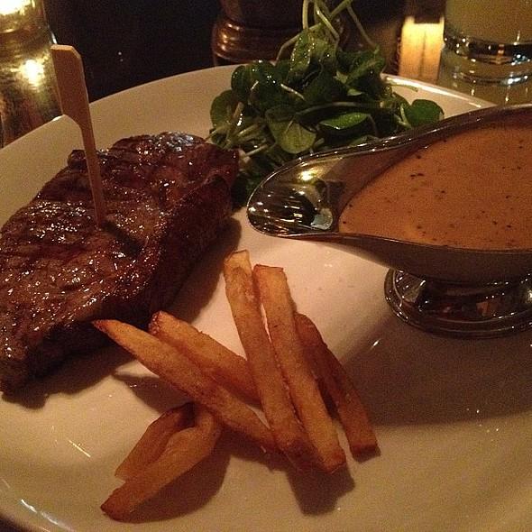 New York strip steak at Neighbourhood in Spinningfield. Medium rare. With peppercorn sauce and fries. Delicious! One of best steaks ever had. Mmm @ Neighbourhood