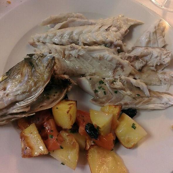 Branzino al forno con patate e pomodorini @ Hostaria Malcanton