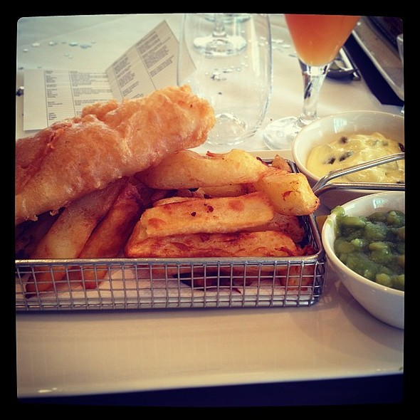 Fish and Chips - in it's own chippy type basket thing. Mushy peas and tartare sauce @ Formby Hall Golf Resort & Spa