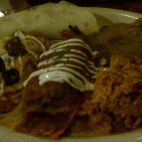 Adobe Mexican Combo (Tamale, Crispy Beef Taco, Chicken Soft Taco And Vegetable Enchilada Served With Spanish Rice And Refried Beans)