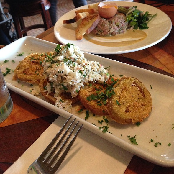 Dungeness Crab Over Fried Green Tomato - Toulouse Petit Kitchen & Lounge, Seattle, WA