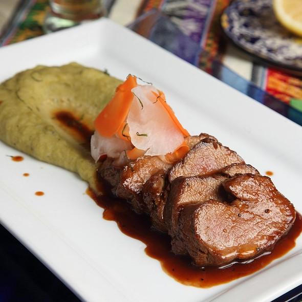 Roasted Pork Tenderloin - Mango Peruvian Restaurant, St. Louis, MO