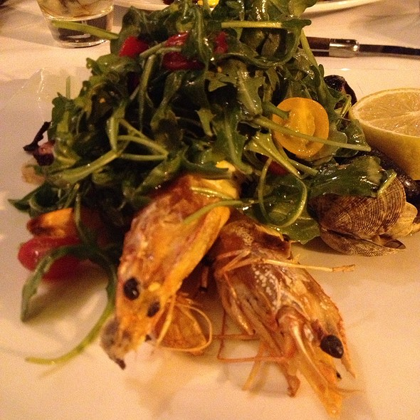 ... Grilled Prawns, Octupus, Calamari, Mussel, And Clams Arugula Salad