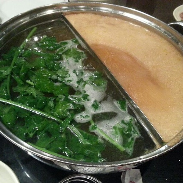 Boiling broth and veggies @ Hipot Hot Pot Restaurant