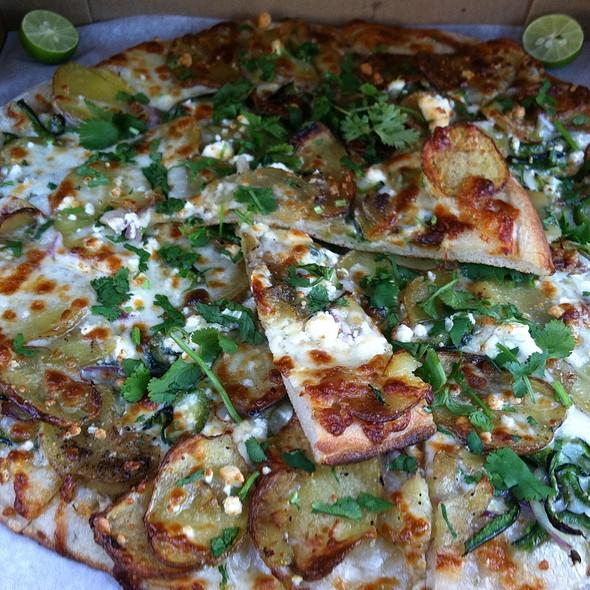 Pizza: Roasted Potatoes Yellow Onions Chile Pasilla Mozzarella Bulgarian Feta Cheese Cilantro Garlic Olive Oil Mexican Key Limes @ Sliver