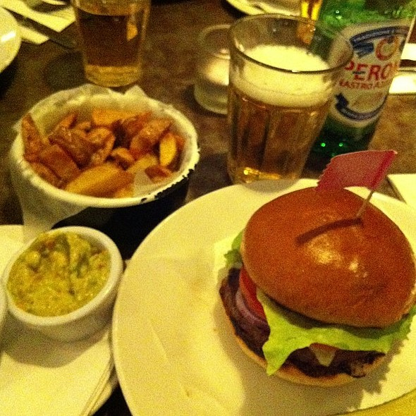 Medium rare burger, guacamole, blue cheese, skin on fries, peroni @ Byron