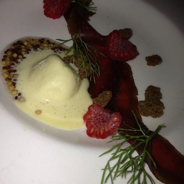 Semi Cured Elk W/ Dijon Ice-Cream, Black Bread, And Rasberries