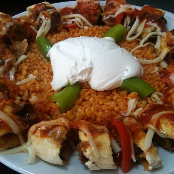 Beyti Sarma / minced meat kebab roll served with yoghurt and tomato sauce