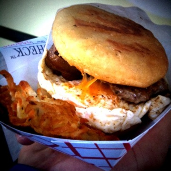 Applewood smoked bacon buttermilk biscuit breakfast sandwich with Rosemary hash browns @ Buttermilk Truck