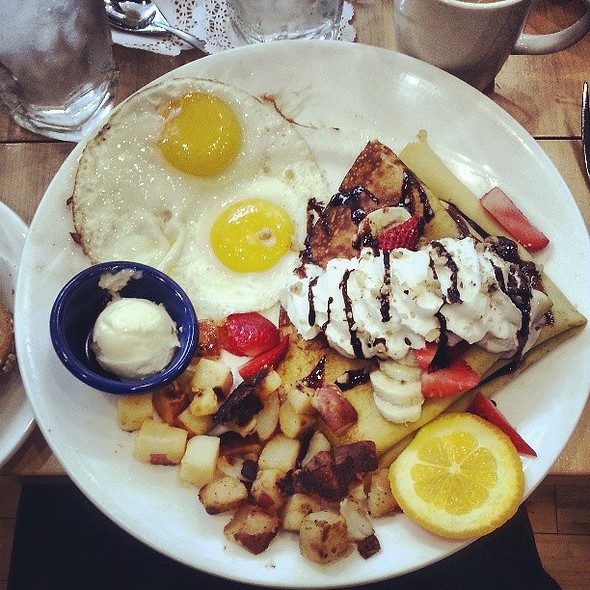Strawberry nutella crepe with sunny side up eggs and hash browns. @ Yolk