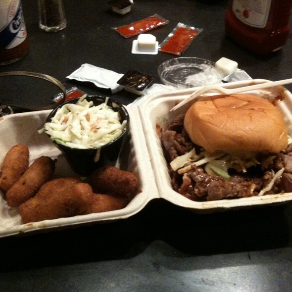 beef brisket sandwich with hush puppies and cole slaw @ Buz and Ned's Real Barbecue