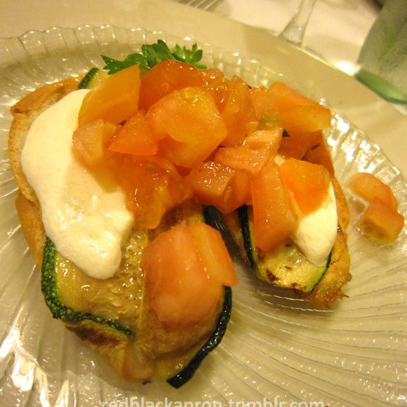 Warmed Fresh Mozzarella with Grilled Zucchini Over Pesto Crostini @ Panini's