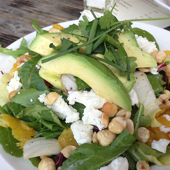 Arugula/Endive/Radicchio Salad with Orange Segments,Sonoma Goat Cheese,Avocado,Hazelnuts and Garlic Vinaigrette - Solace & The Moonlight Lounge, Encinitas, CA