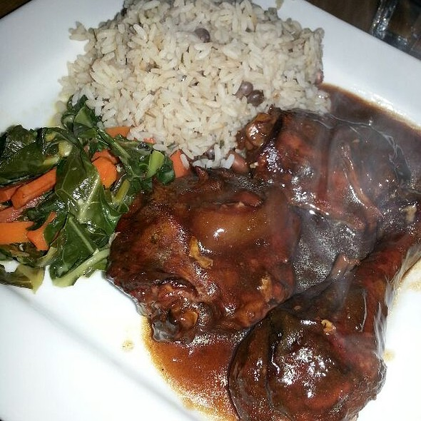Stewed Chicken With Collard Greens & Coconut Rice And Peas