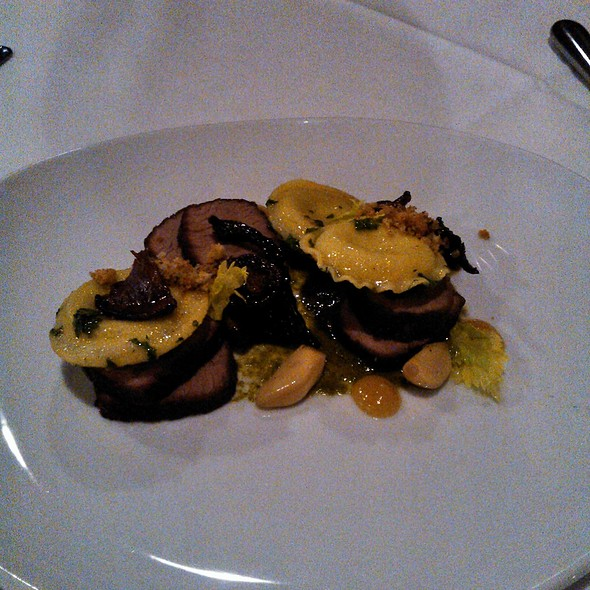Charred spring onion ravioli and brisket with chanterelles