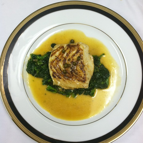 Chilean Sea Bass pan-seared over spinach with Capers  in a white wine lemon sauce - Cafe Mezzanotte, Wilmington, DE