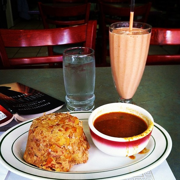 Feast with your mouth, not your eyes. Mofongo (mashed green plantains with pork skin and gravy with tomatoes and onions) and zapote milk shake @ El Castillo De Jagua II