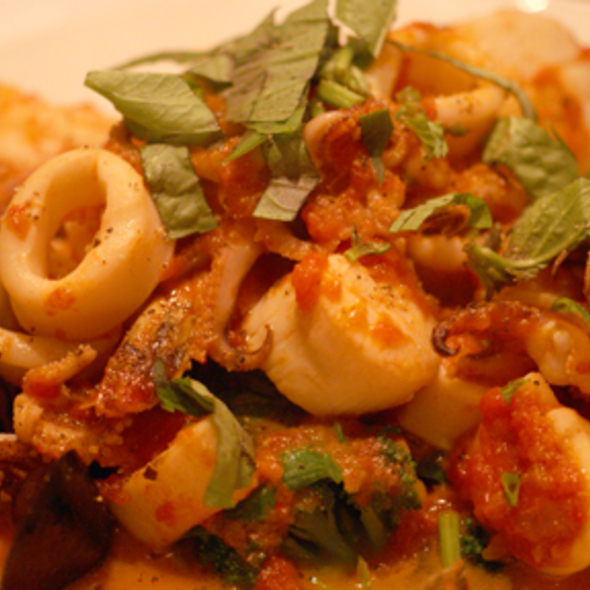 shrimp, calamari, scallops and mussels in a spicy tomato sauce over broccoli and spinach @ Bistango